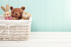 stuffed animals in a basket